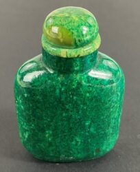 A Stained Emerald Green Walrus Chinese Snuff Bottle, 19th Century | Sold for $3,750