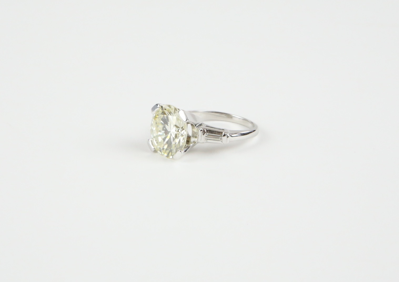 G.I.A. CERTIFIED 5.10 CT. DIAMOND AND GOLD RING | Sold for $22,800